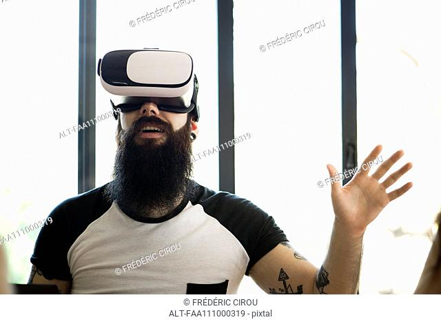Man using virtual reality simulator