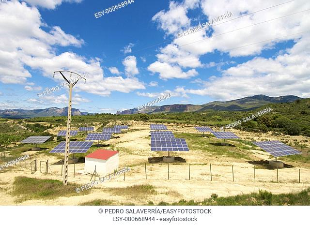 Solar field with blue sky with clouds