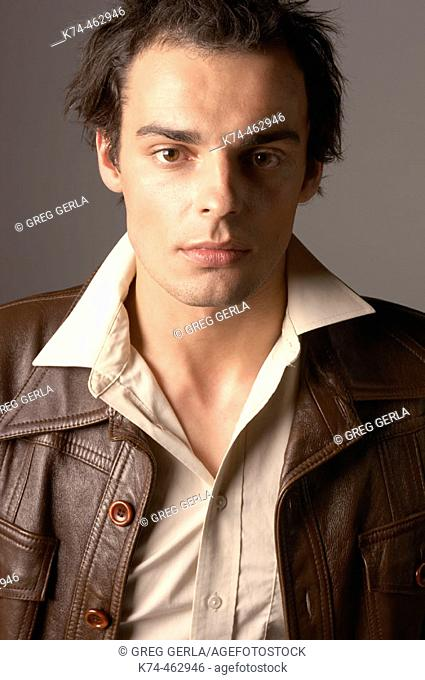 fashion image of young man in leather jacket