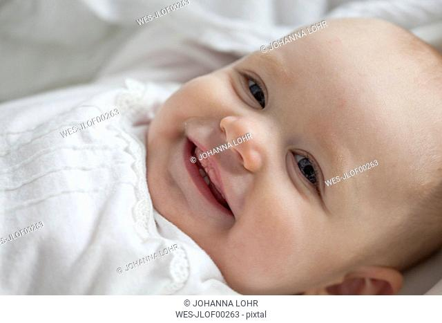 Portrait of smiling baby girl, close-up