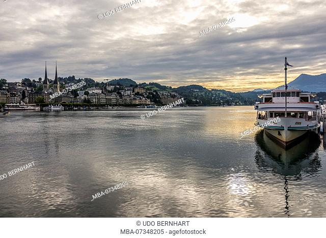 Shipping pier and view of the north shore with court chapel St. Leodegar, Lucerne, Lake Lucerne, Canton of Lucerne, Switzerland