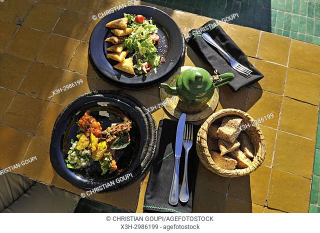 assortment of Moroccan Salads and mixed briouates, dishes served at the restaurant Le Jardin in the medina, Marrakesh, Morocco, North Africa