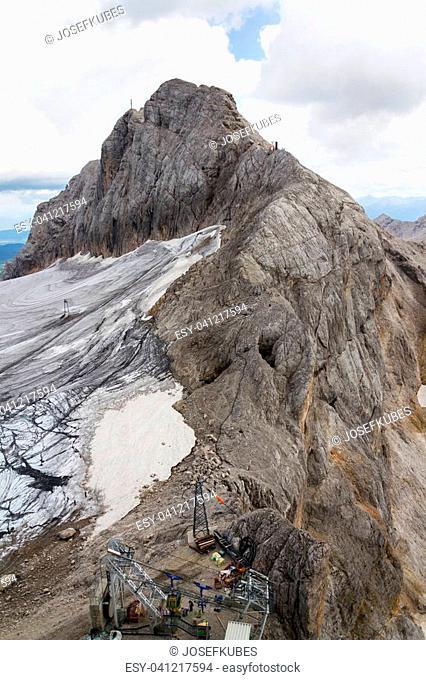 People climbing via Koppenkarstein ferrata near Dachstein glacier, Austrian Alps