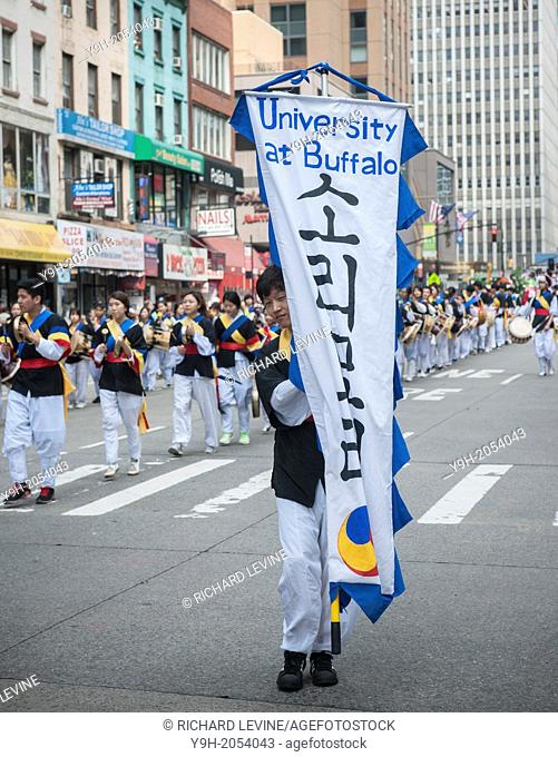 College students march down Sixth Avenue in New York with their school pennants in the Korean Parade
