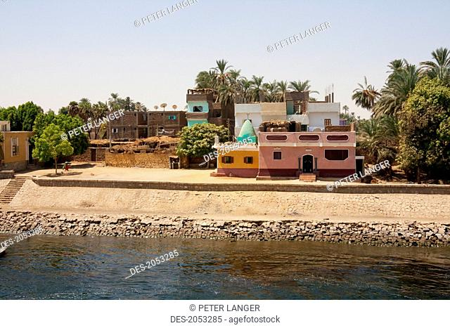 Village By The Shore Of The Nile River Between Aswan And Edfu, Aswan, Egypt