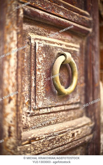 Knocker on old wooden door  Photo taken on Sardinia, Italy  Very shallow depth of field