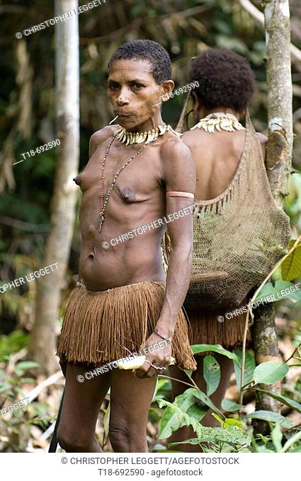Papuan tribeswomen in jungle, Indonesia
