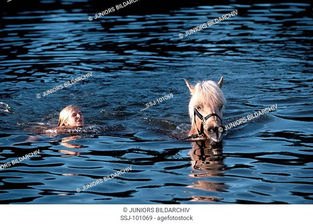 girl and Icelandic horse in water