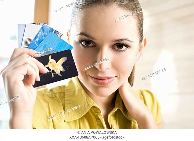 portrait of woman with credit cards