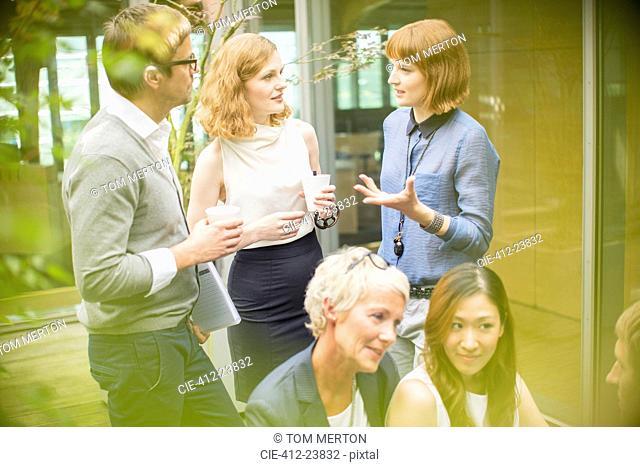 Business people talking in courtyard