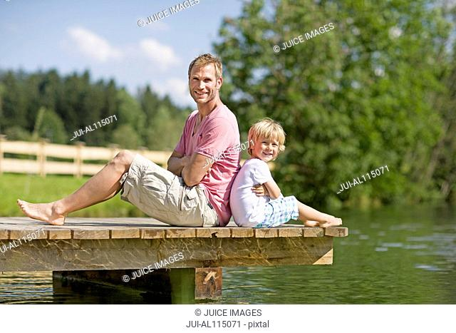 Father and young boy on jetty