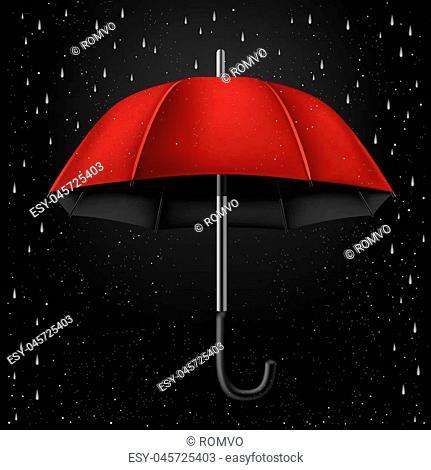 The opened red umbrella on rainy dark background