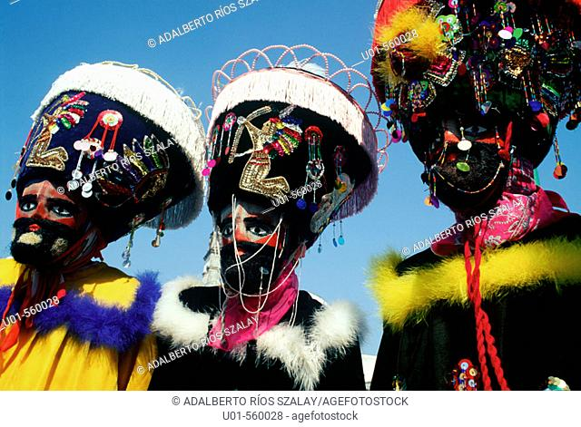 Chinelo dancers. El Brinco del Chinelo began in Ylayacapan in the XIXth century. The dancers use masks with a beard, a stick with colours that change depending...
