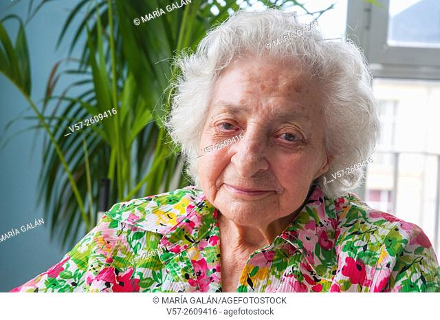 Portrait of old woman smiling and looking at the camera