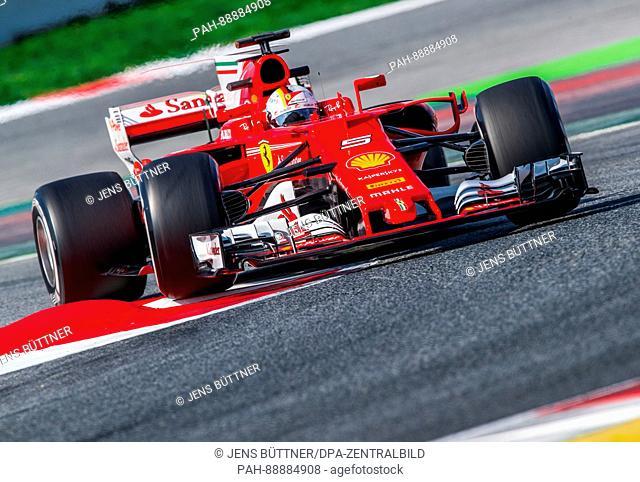 German Formula One pilot Sebastian Vettel of Ferrari in action during the testing before the new season of the Formula One at the Circuit de Catalunya race...