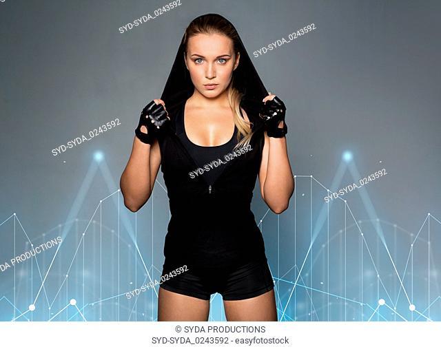 young woman in black sportswear posing
