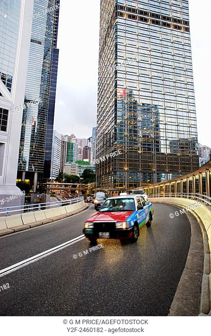 traffic on curved, elevated roadway in the Admiralty district, with sections of Bank of China Tower and Chung Kong Centre buildings, Hong Kong