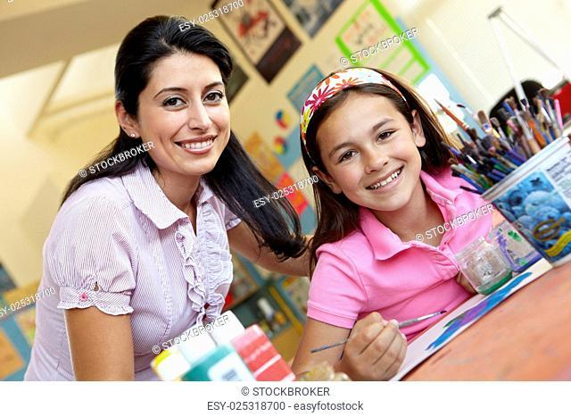 Teacher and pupil in art class