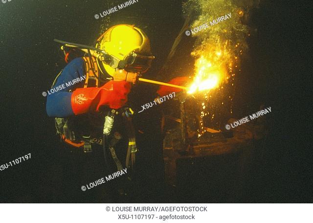 Commercial diver welding underwater