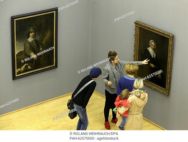 Visitors look at the paintings 'Portrait of a man in a landscape' (1642, L) and 'Portrait of a woman' by Dutch painter Govert Flinck (1615-1660) featured in the...