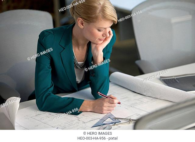 female architect with plans