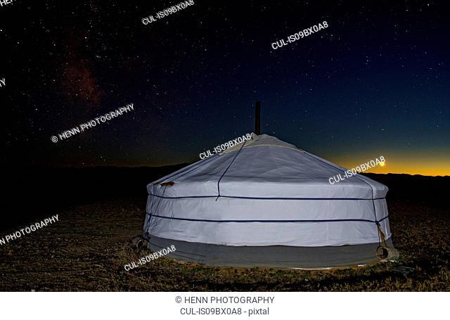 Ger or yurt camp under starry night sky, Gobi desert, Mongolia
