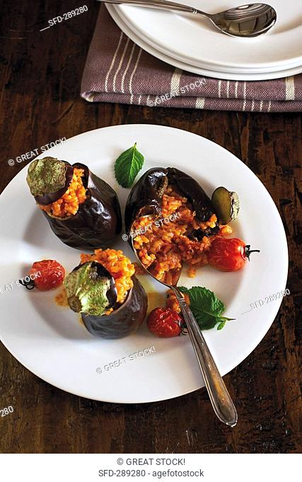 Baby aubergines stuffed with tomato risotto