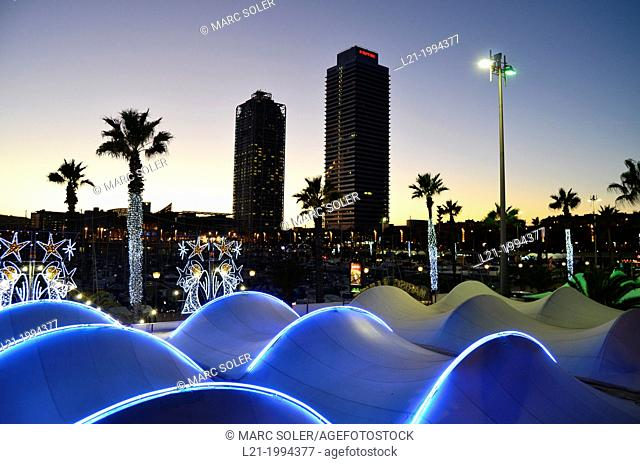 Hotel Arts, Mapfre Tower, Port Olímpic at sundown. Palm trees, neon lights, silhouettes. Port of Barcelona, Barcelona, Catalonia, Spain