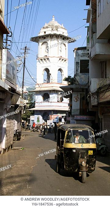 Auto rickshaw and clock tower Udaipur Rajasthan India