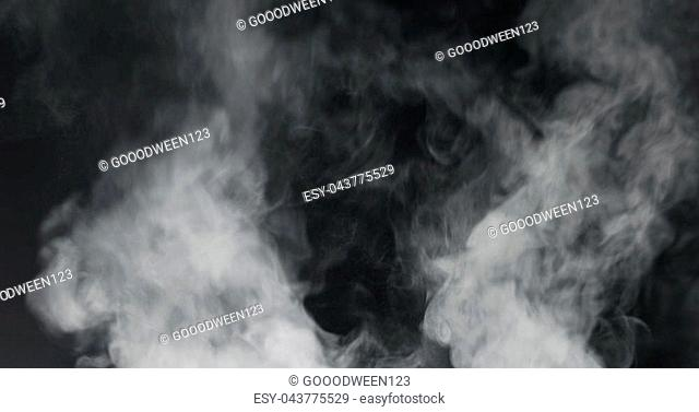 vapor steam rising over black background, wide photo