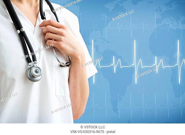 Female nurse with stethoscope against EKG test graph