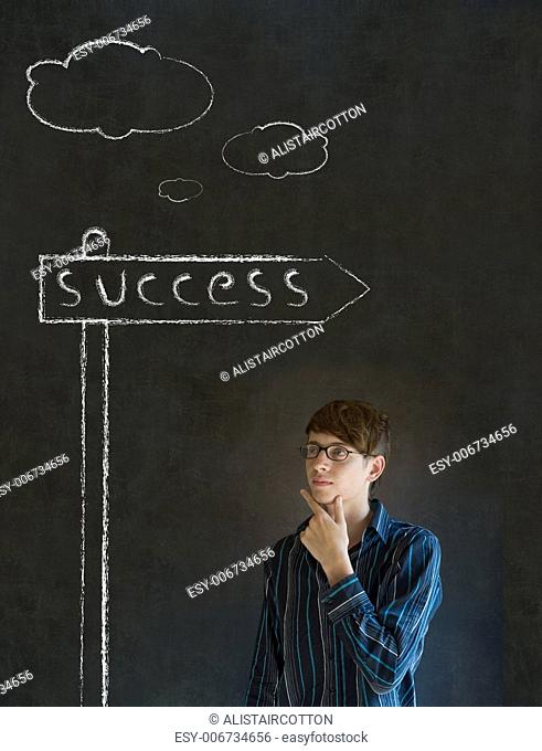 Business man with chalk success road street sign on blackboard background