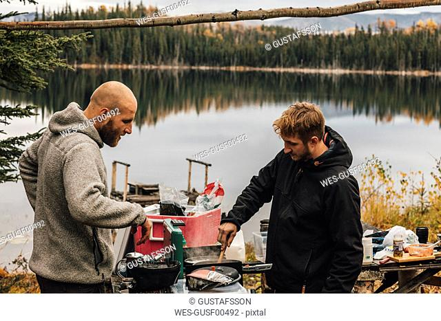 Canada, British Columbia, two men cooking at Blue Lake