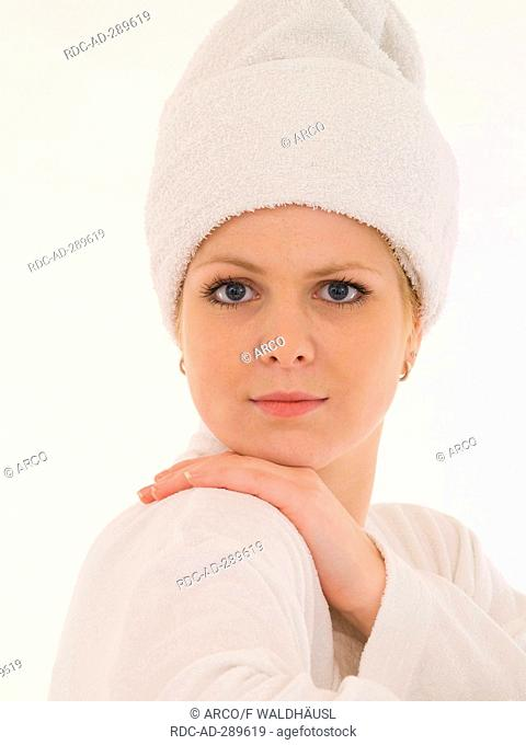 Young woman wit a white towel on her head