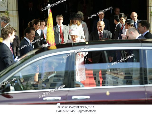 Britain's Queen Elizabeth II and Prince Philip depart from Hotel Adlon on their way to the Queen's birthday party held at the residence of Britain's ambassador