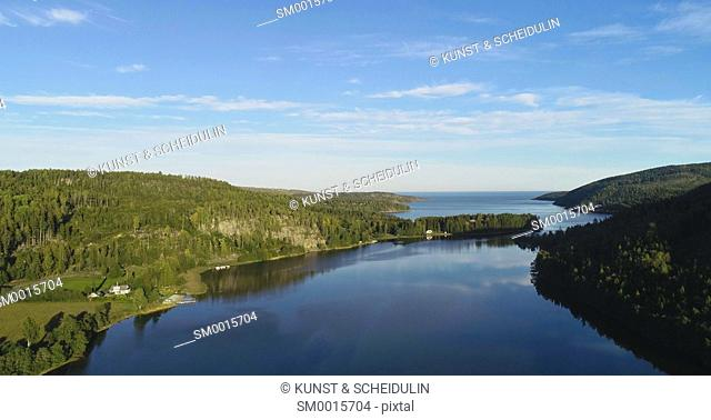 Aerial shot of a glassy bay of the Baltic Sea at the Swedish High Coast (Höga Kusten)on a sunny summer day