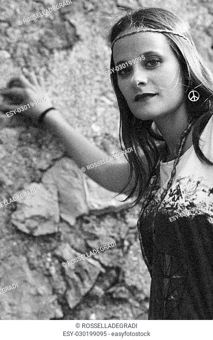 Girl with earring hippie peace symbol, make love not war. photography vintage style