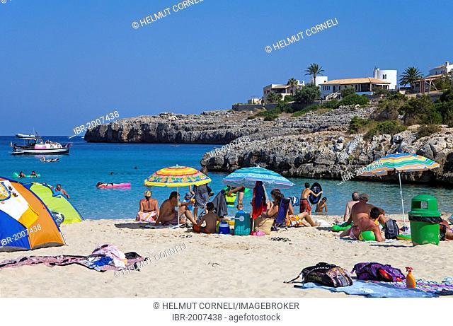 Family vacation on the beach of Cala Marcal, Porto Colom, Felanitx, Majorca, Balearic islands, Spain, Mediterranean Sea, Europe