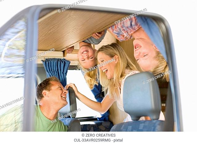 Family smiling in recreational vehicle