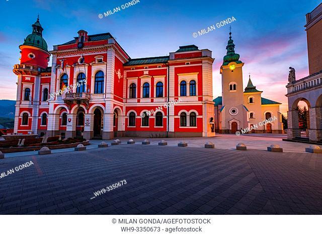 Ruzomberok, Slovakia - April 26, 2019: Town hall and a church in the main square of Ruzomberok