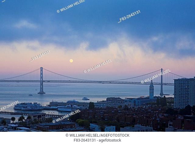 Moonrise over San Francisco-Oakland Bay Bridge western span, dusk