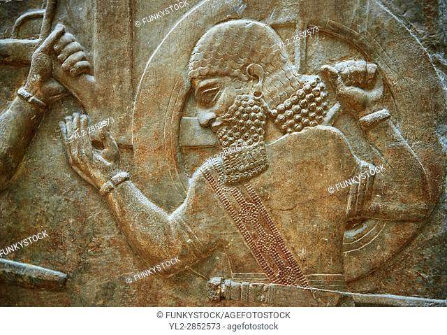 Stone relief sculptured panel of soldiers carrying a war chariot . Facade L. Inv AO 19884 from Dur Sharrukin the palace of Assyrian king Sargon II at Khorsabad