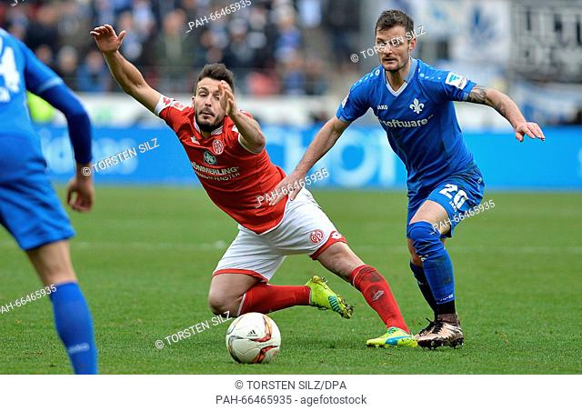 Mainz's Giulio Donati (L) and Darmstadt's Marcel Heller vie for the ball during the German Bundesliga soccer match between FSV Mainz 05 and Darmstadt 98