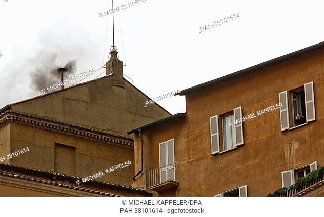Black smoke rises from the chimney of the Sistine Chapel in Vatican City, Vatican, 13 March 2013. A further unsuccessful round of voting is signaled with black...