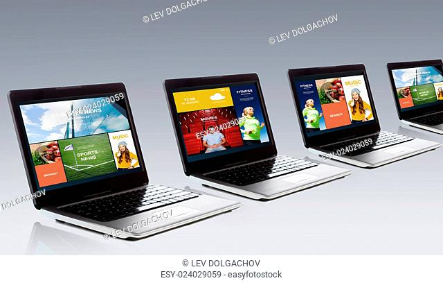 technology, media, multimedia and advertisement concept - laptop computer with internet applications on screen over gray background