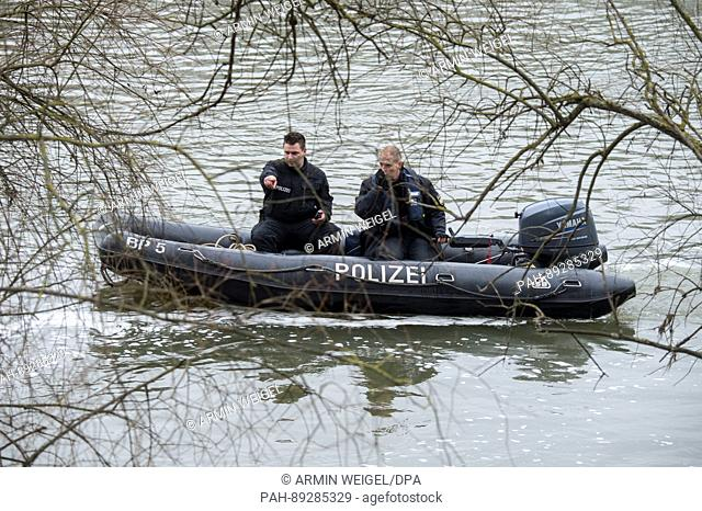 Police officers look for the missing student Malina K. on the Donau river in Regensburg, Germany, 24 March 2017. The 20-year-old student went missing on her way...