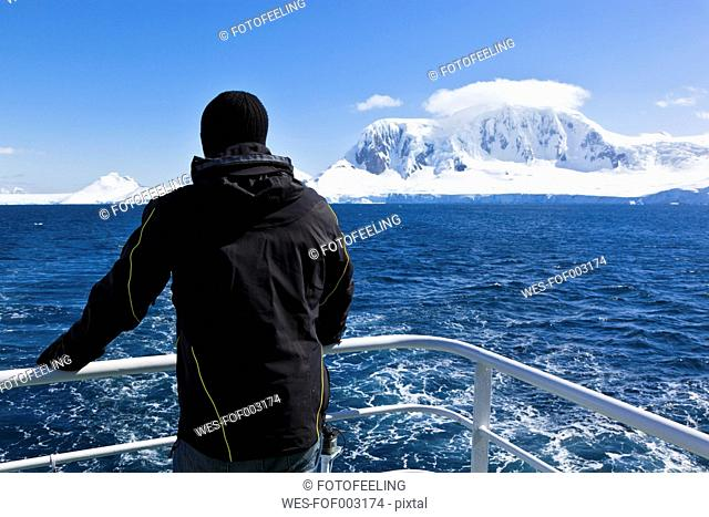 South Atlantic Ocean, Antarctica, Antarctic Peninsula, Gerlache Strait, Tourist standing on polar star icebreaker cruise ship