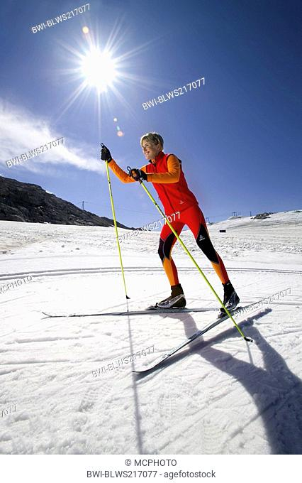 female cross-country skier in the snow, skating, Austria