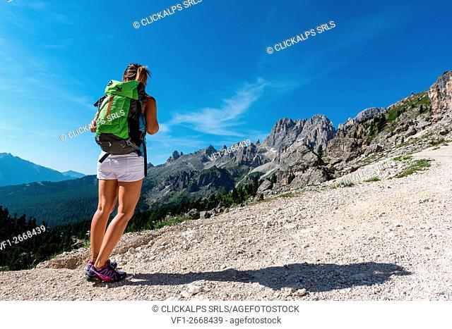 Italy, Trentino Alto Adige, Val di Fassa, Hiker on his way