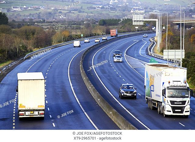 cross border freight and vehicle traffic on the N1/M1 motorway crossing the irish border between Northern Ireland and Republic of Ireland soon to be the UK EU...